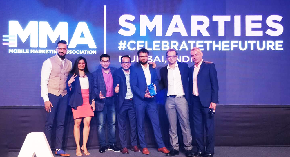 Affle Co Founder Anuj Kumar along with team receiving the Technology Company of the Year Award @ the MMA Smarties Ceremony