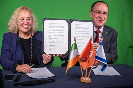 BGU President Prof. Daniel Chamovitz (right) and Vice-President for Global Engagement Prof. Limor Aharonson-Daniel (left) sign the agreement on Monday during a virtual ceremony on the Marcus Family Camp_us i